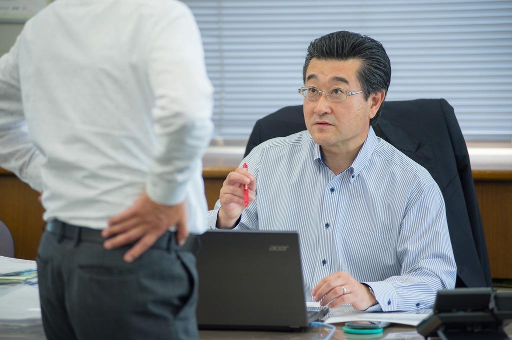 専務取締役 岡田真一郎
